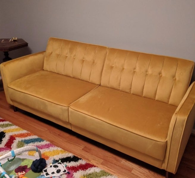 A yellow futon in a reviewer's home