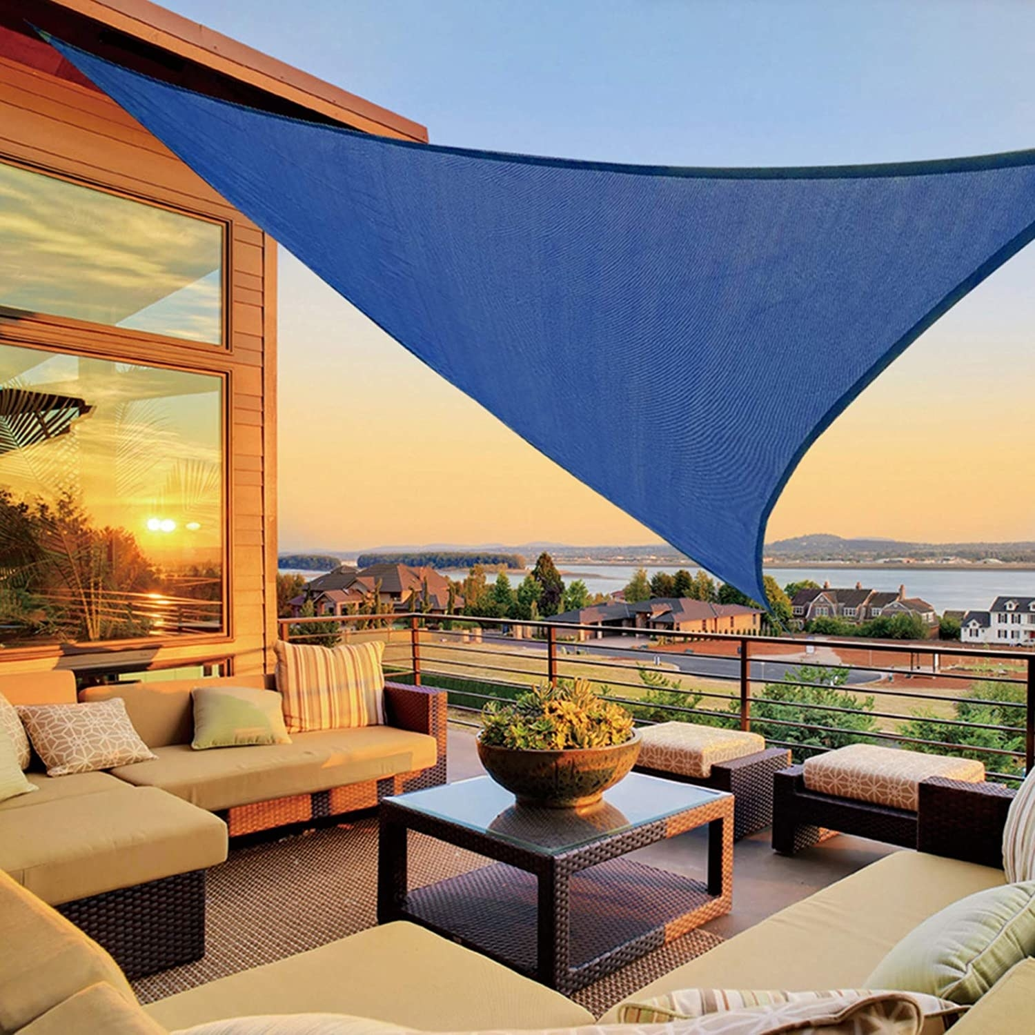 dark blue sunshade triangle above neutral couches on deck