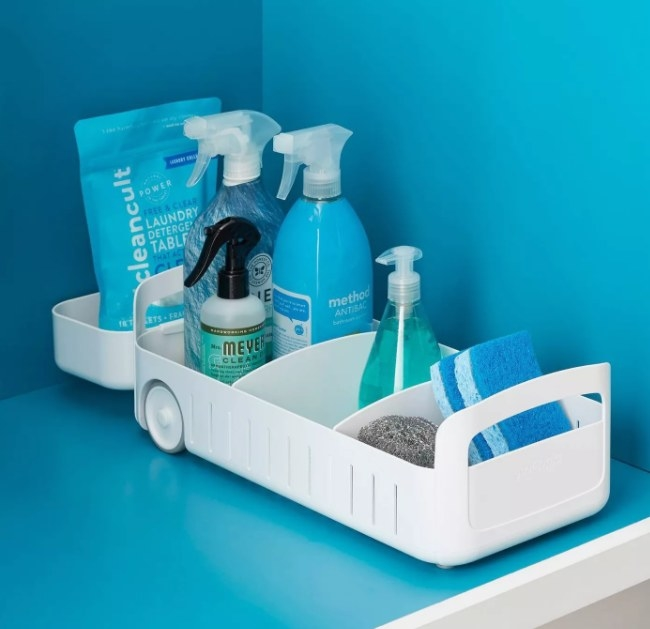 A rollout under sink organizer that can store kitchen essentials and cleaning supplies