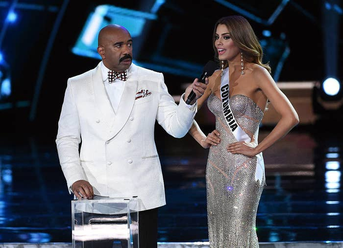 Steve Harvey (L) listens as Miss Colombia 2015, Ariadna Gutierrez Arevalo, answers a question during the interview portion of the 2015 Miss Universe Pageant