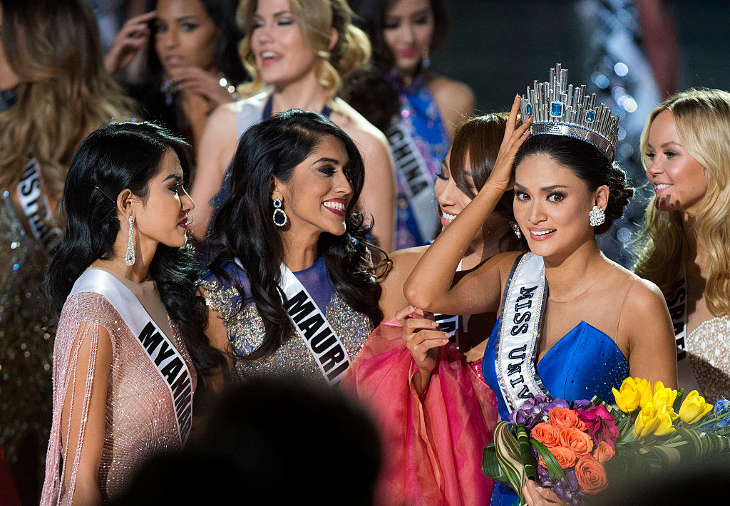 Miss Philippines Pia Alonzo Wurtzbach (R), Miss Universe 2015 is congratulated by pageant friends on stage during The 2015 MISS UNIVERSE Show
