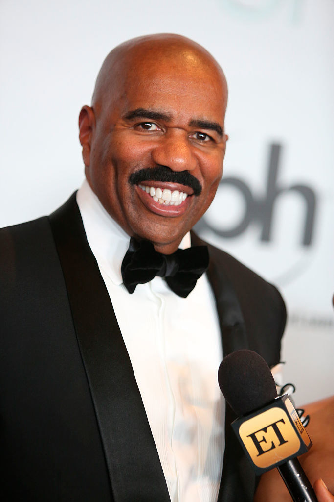 Steve Harvey smiles during the The 64th Annual Miss Universe Pageant Arrivals