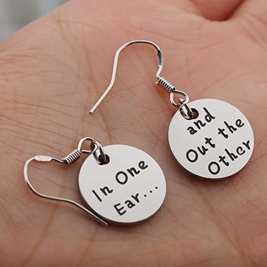 """round earrings, with one reading """"In one ear..."""" and the other """"and out the other"""""""