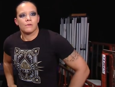 Shayna Baszler with her hands on her hips