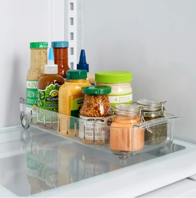 A roll-out fridge caddy (with two dividers) to create compartments for easy storage