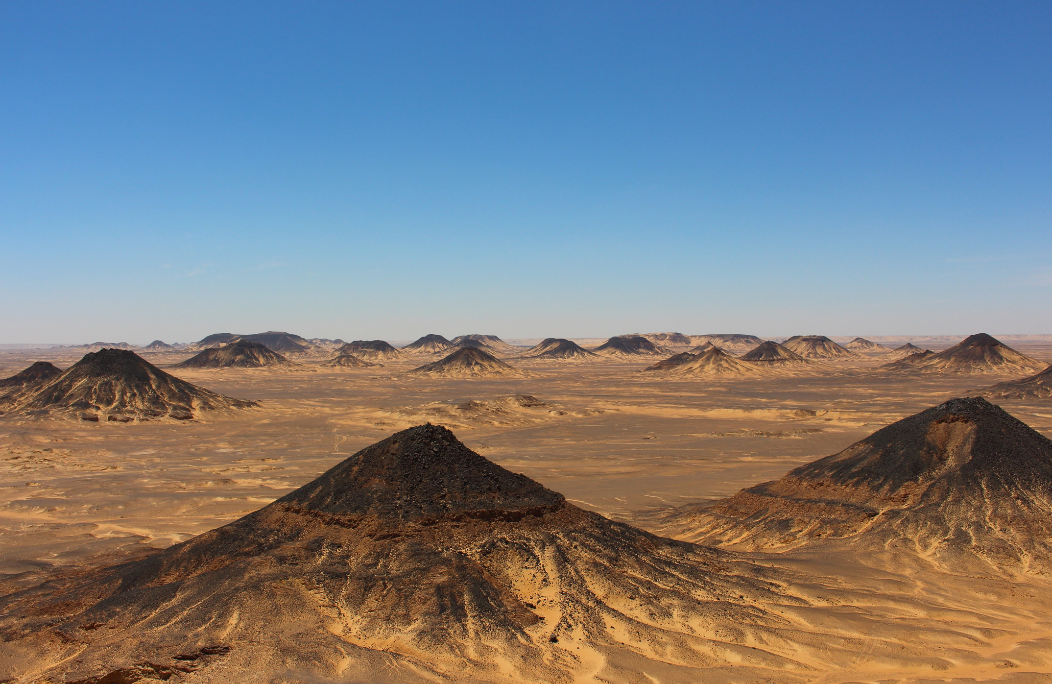 Black capped hills in a desert area