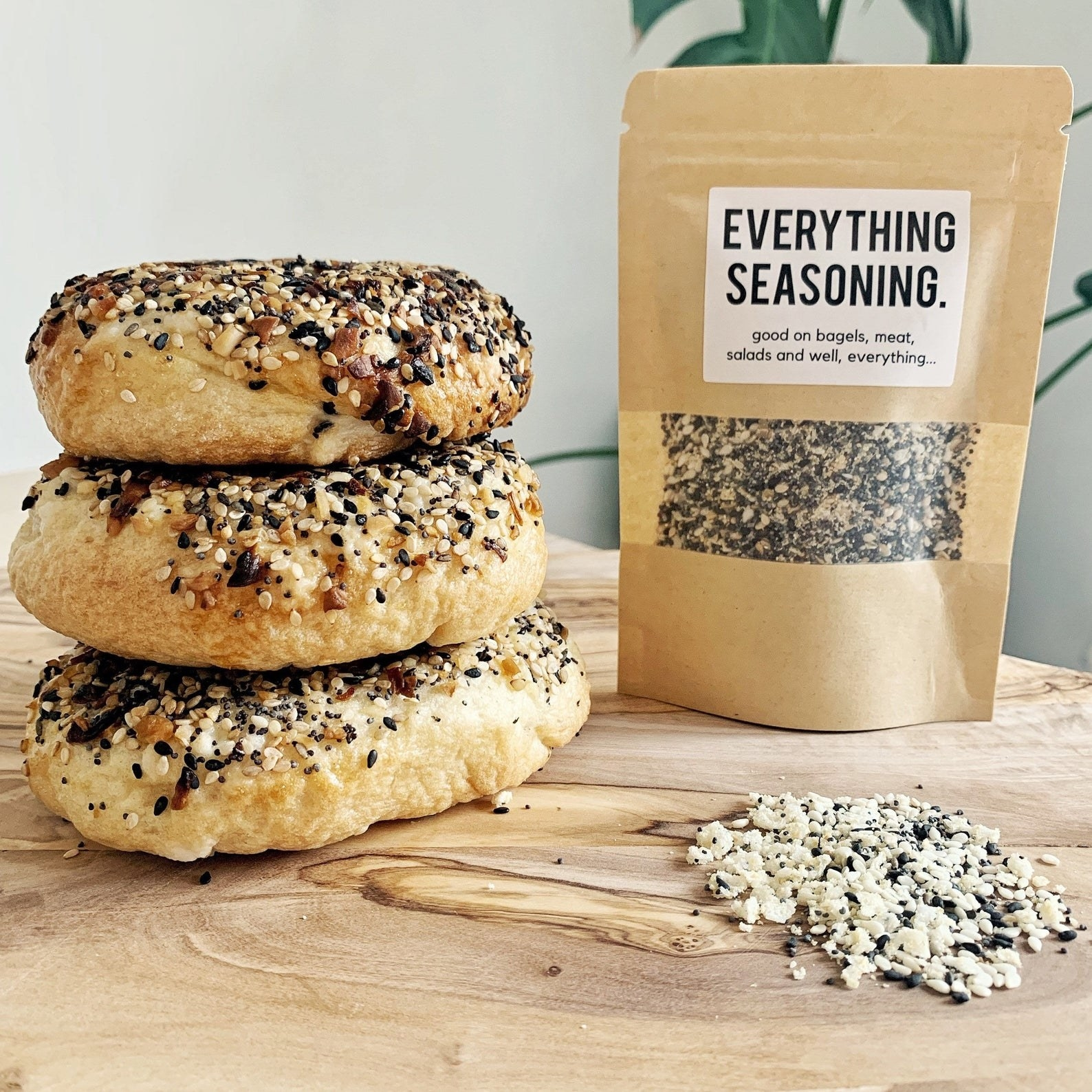 The seasoning package next to a stack of bagels