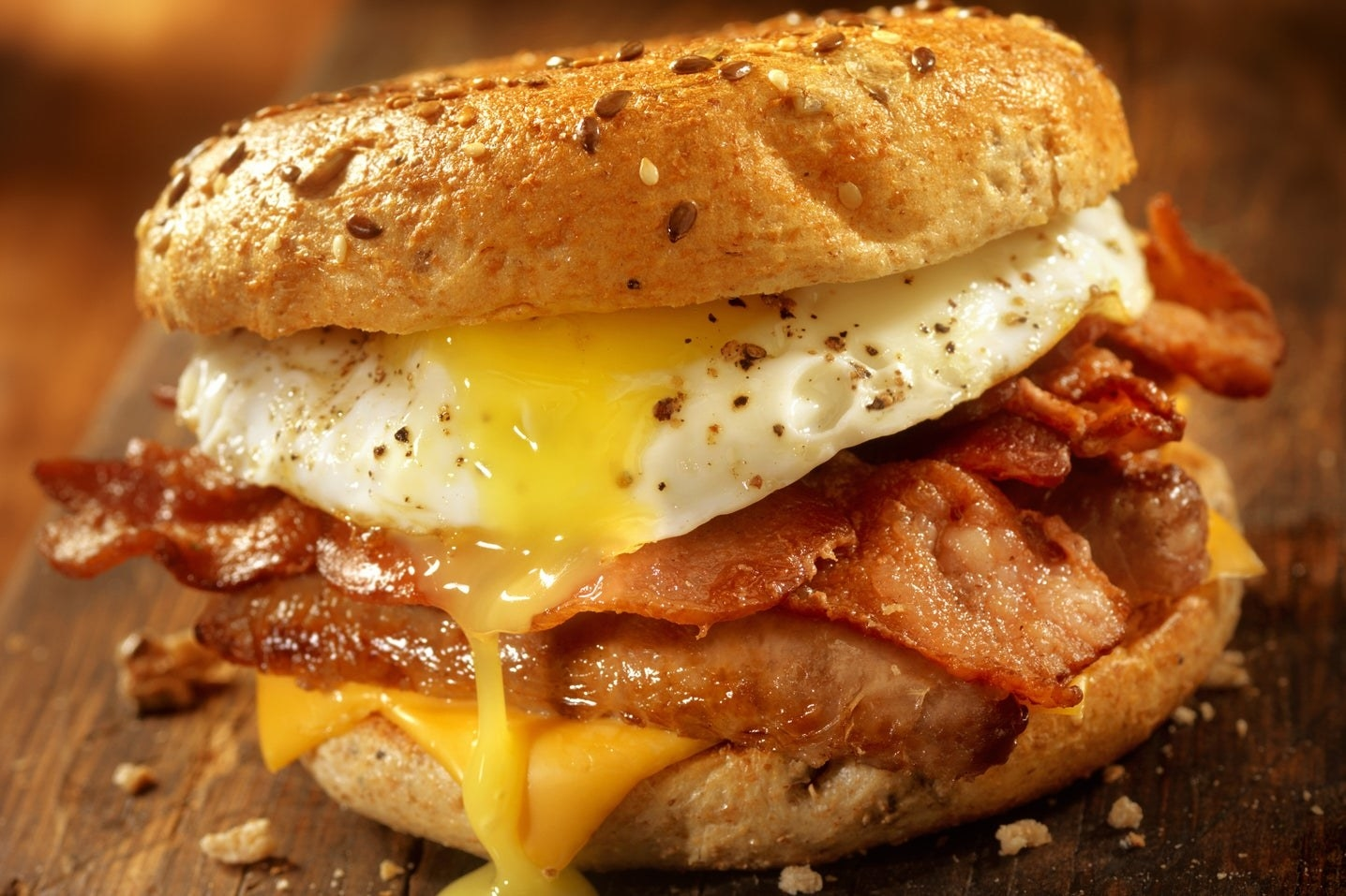 Breakfast sandwich with eggs, bacon, and cheese.