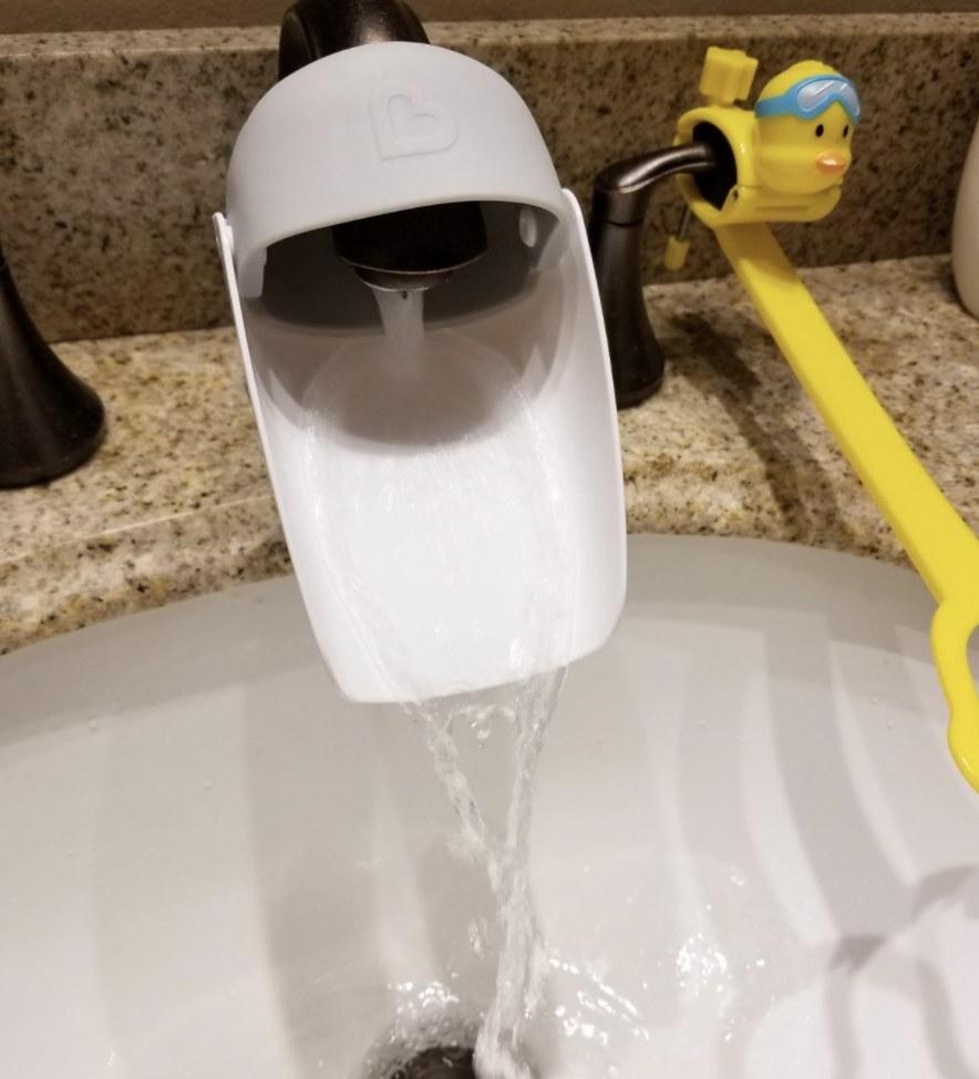 A faucet extender on a faucet