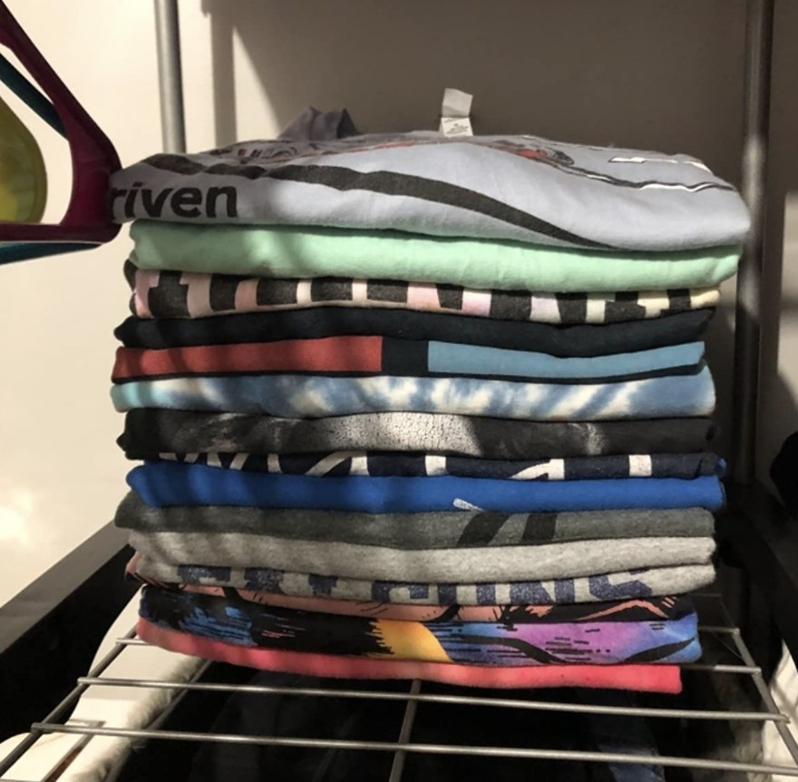 A pile of folded T-Shirts