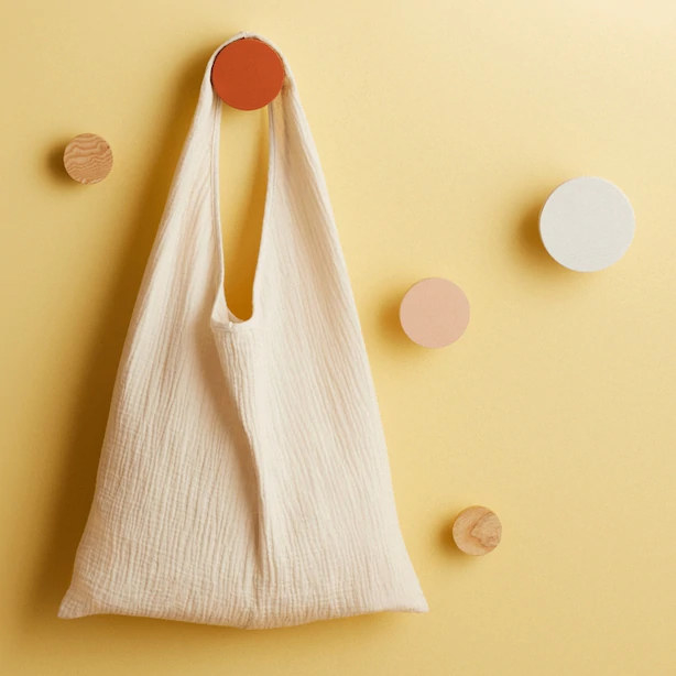 A small bag hanging from a round hook