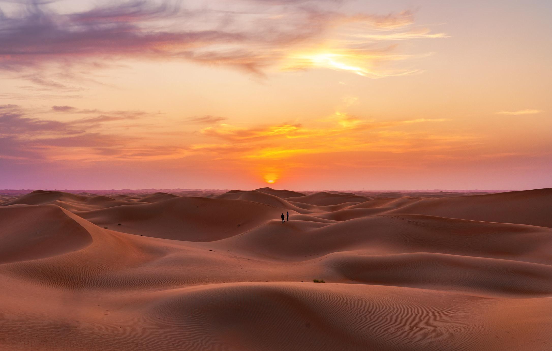 Open desert under orange sky