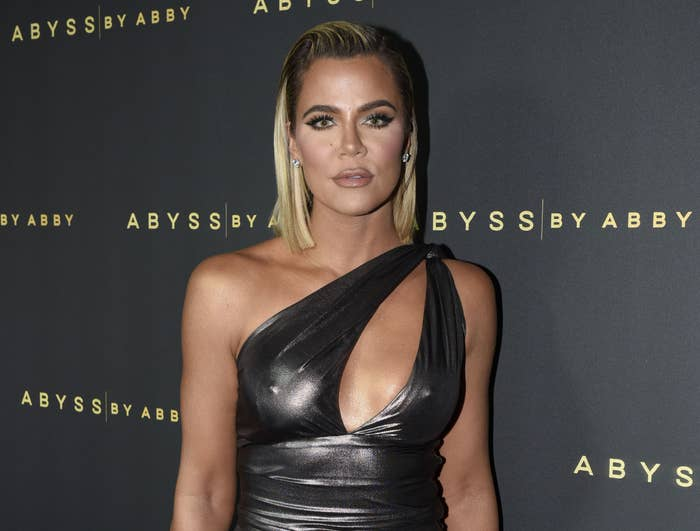 Khloe wears a one shouldered gown at an event