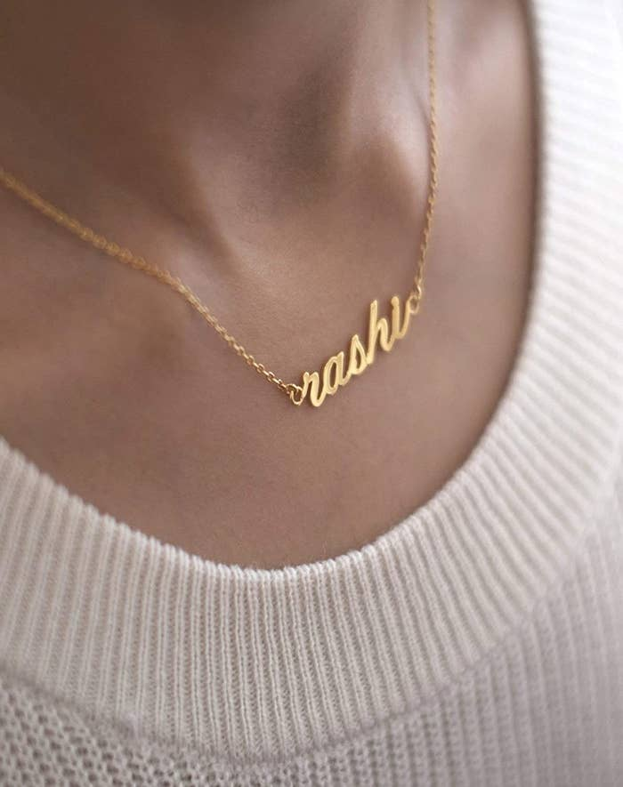 A gold-plated necklace customised with the name 'Rashi'.