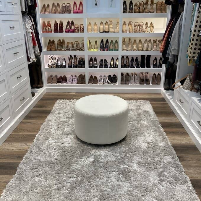 a reviewer's gray area rug in a walk-in closet