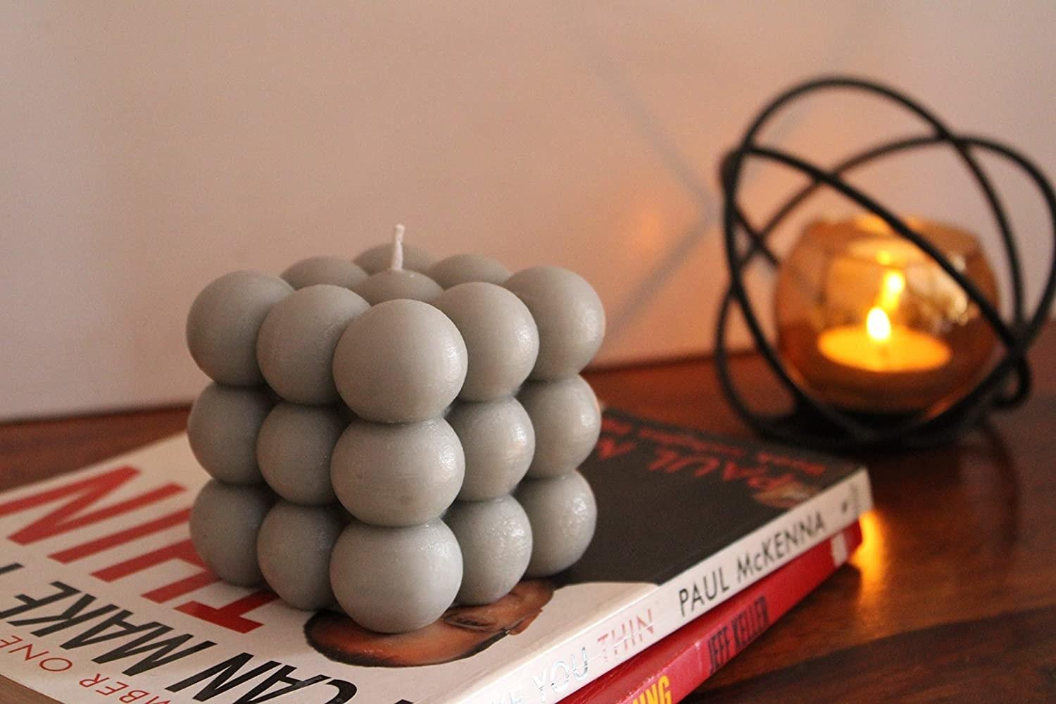 A grey cloud bubble shaped scented candle.