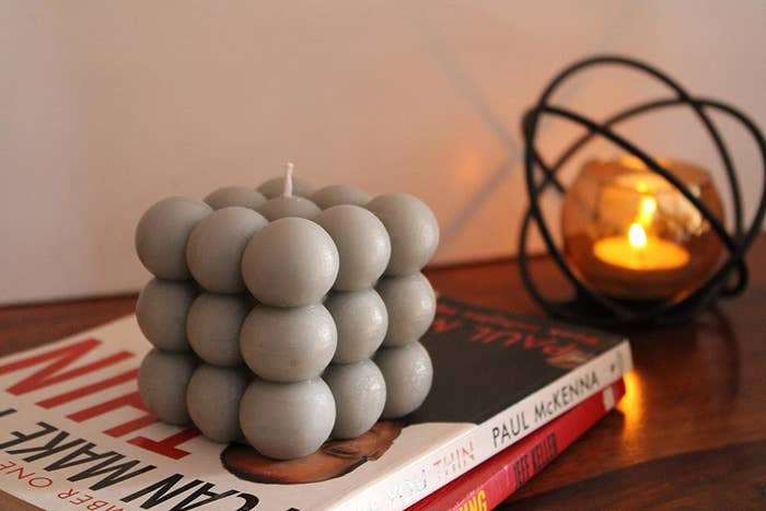 A grey cloud bubble shaped scented candle