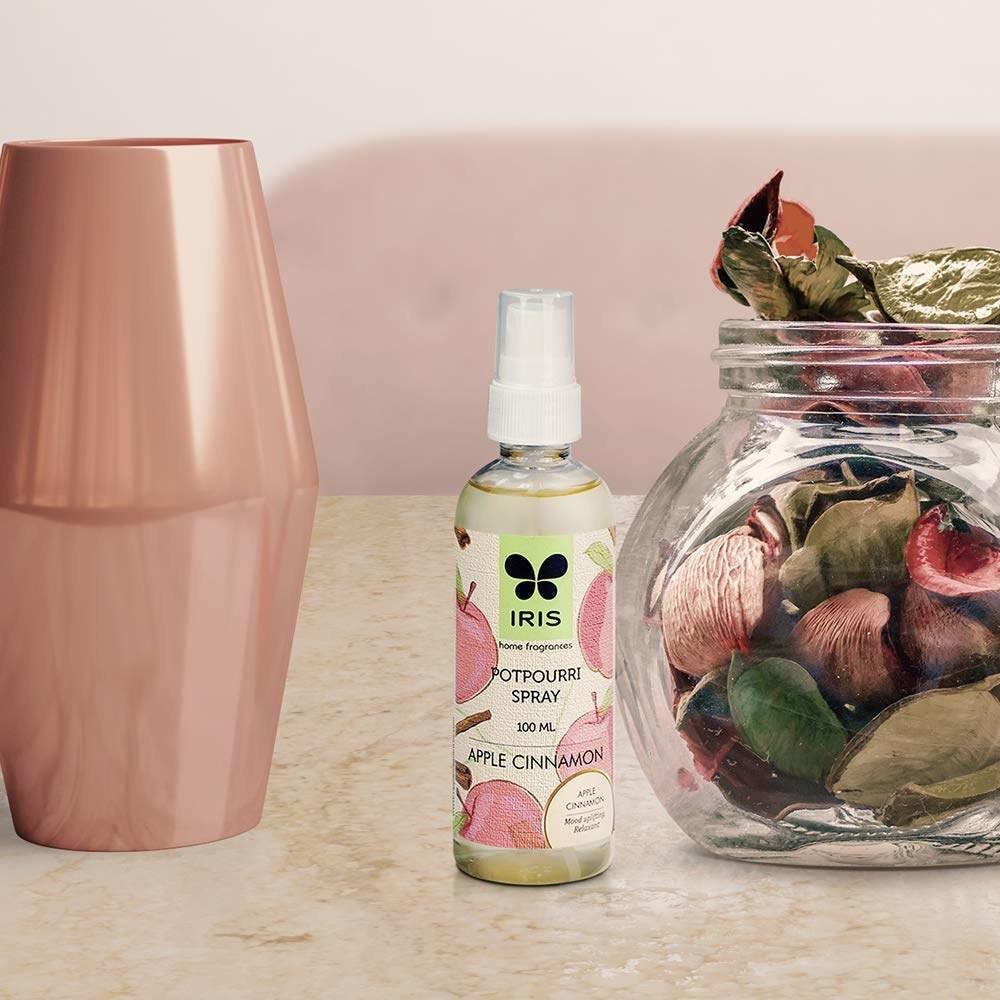 Bottle of the apple cinnamon spray on a table