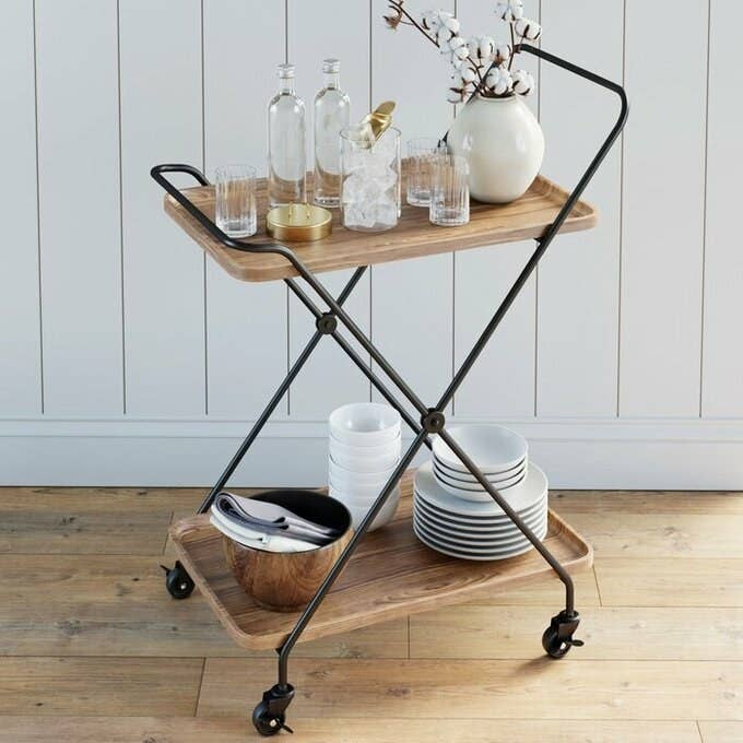 the black bar cart styled with glasses