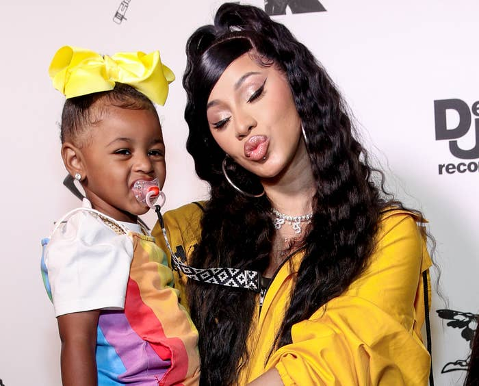 Cardi holds Kulture on a red carpet