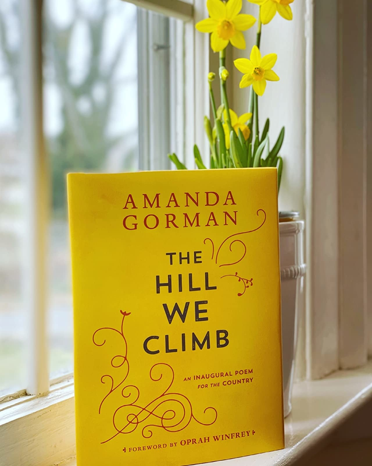 The book, which has a bright yellow cover with red design flourishes