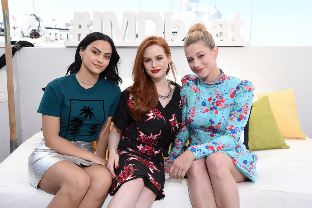 Camila Mendes, Madelaine Petsch and Lili Reinhart sitting on a couch at the #IMDboat at San Diego Comic-Con 2019