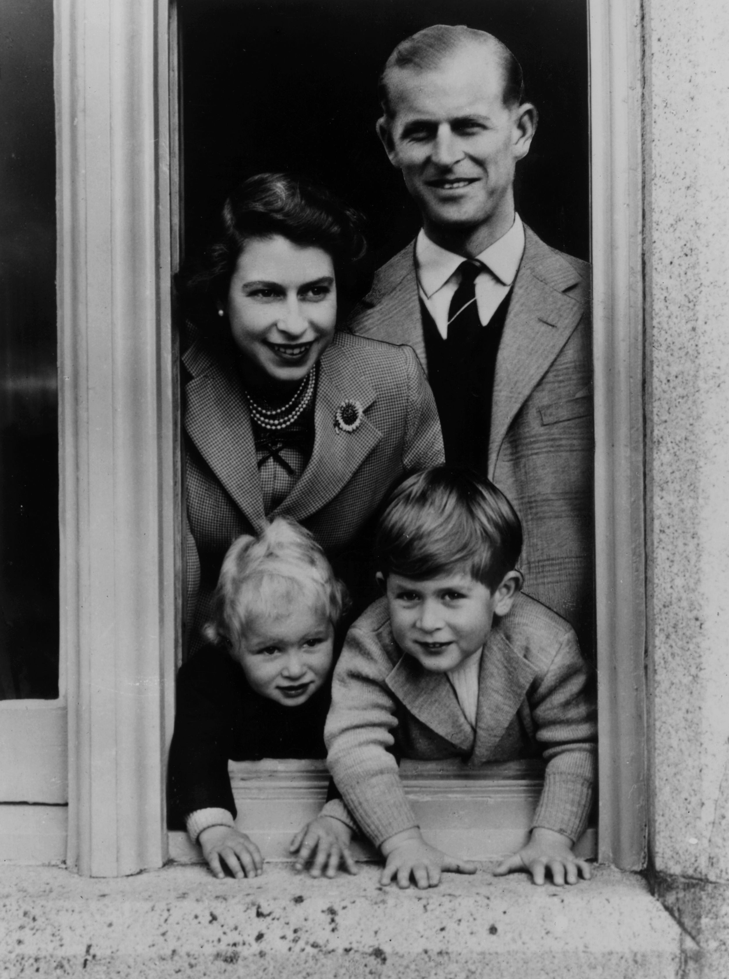 The family stands at a window