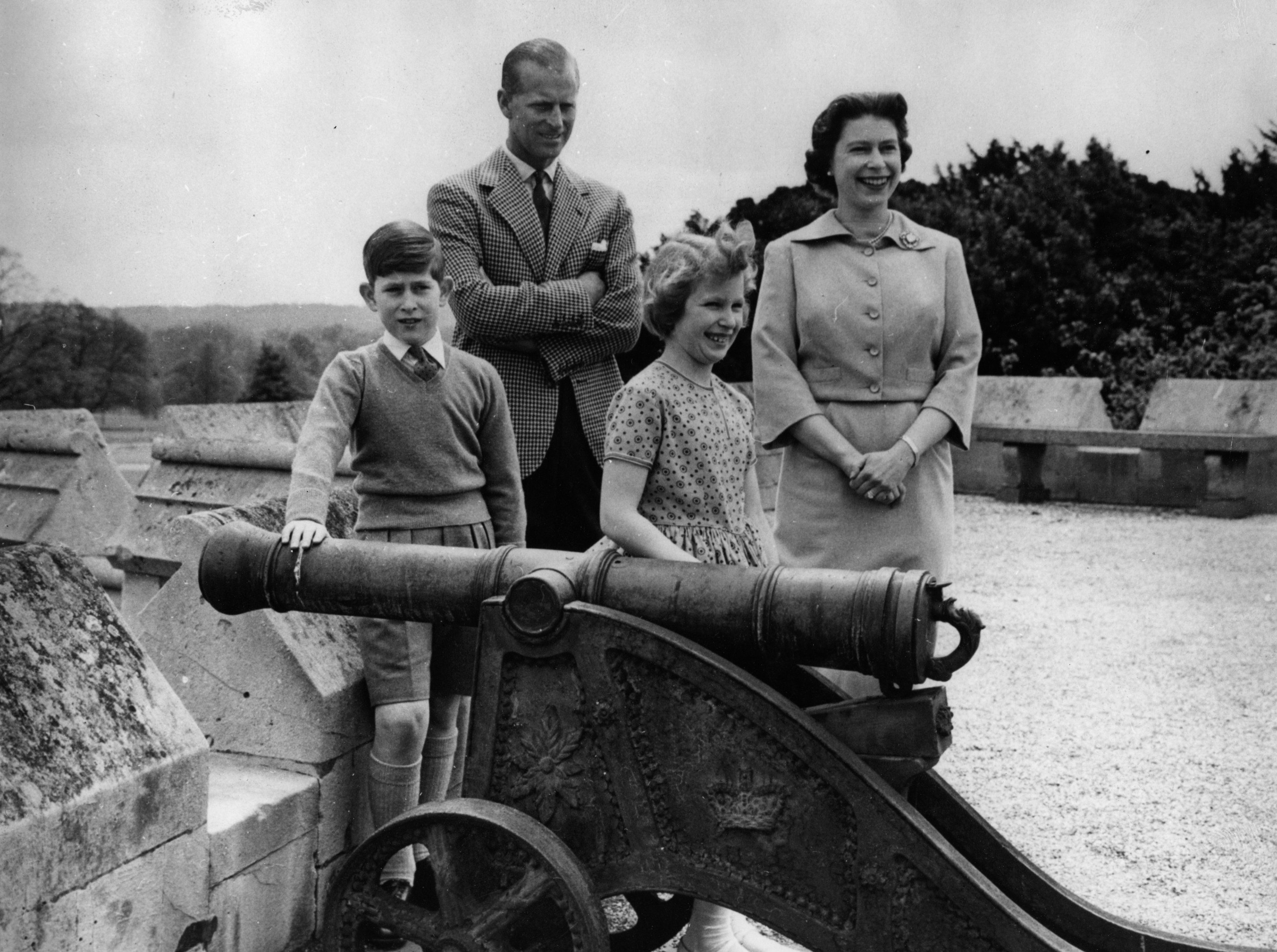 The family stands by a cannon overlooking the countryside
