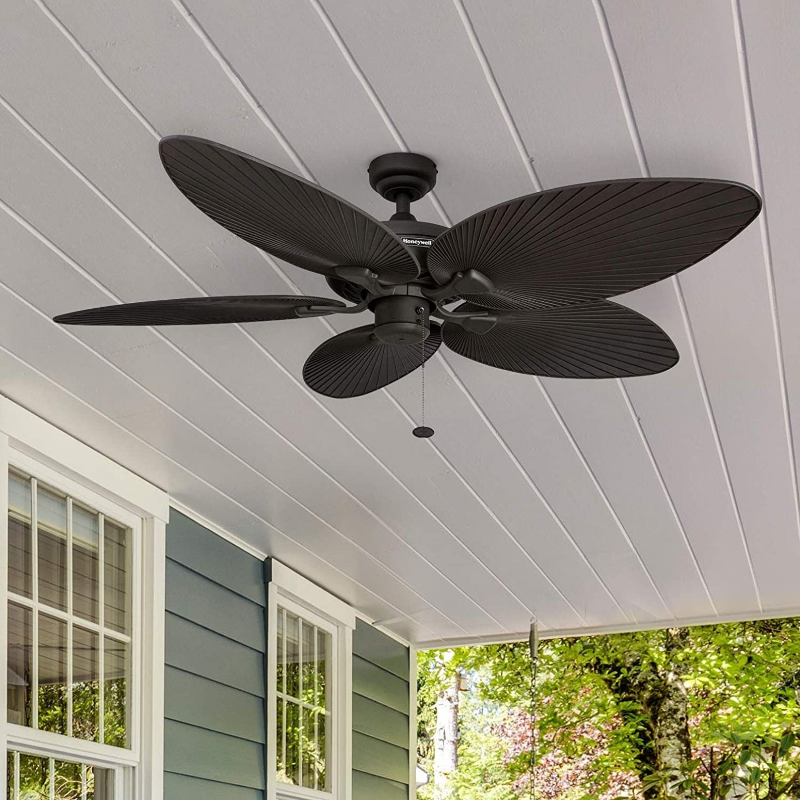 the five palm leaf ceiling fan installed in a roofed outdoor patio