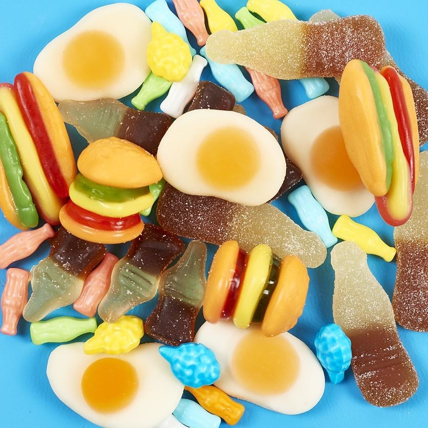 a pile of gummy candy shaped like junk food items