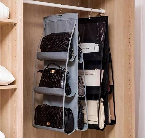 two different-colored, double-sided handbag organizers hanging in a closet