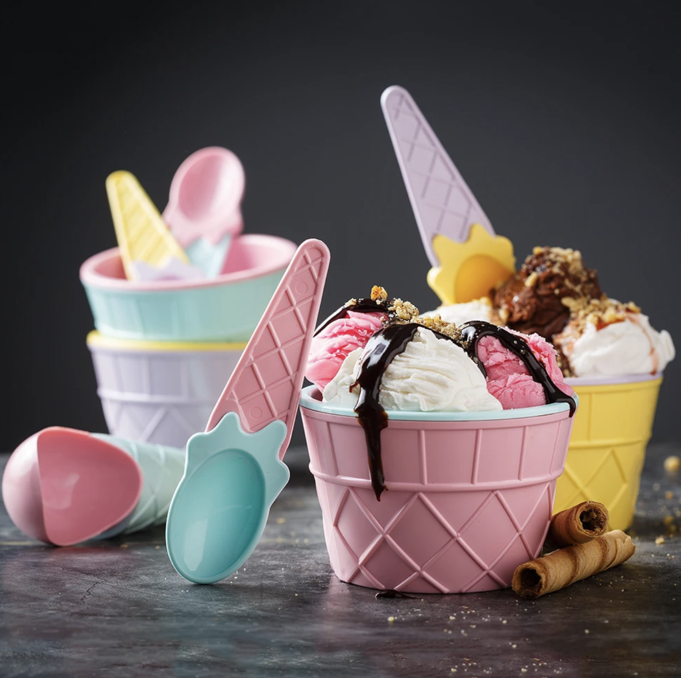 the reusable ice cream cup set with several scoops of ice cream in two of the cups