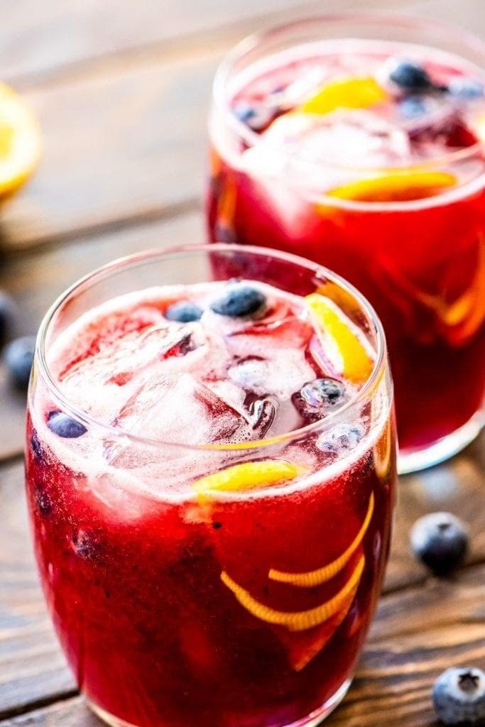 Two glasses of blueberry lemonade.