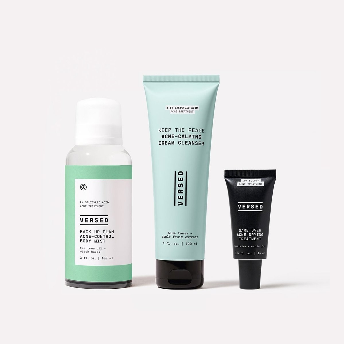 a bottle of acne control mist, a tube of cleanser, and a smaller tube of an acne drying treatment