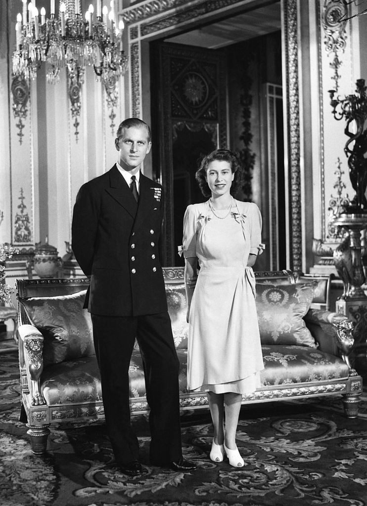 Prince Philip and Elizabeth standing in a grand room