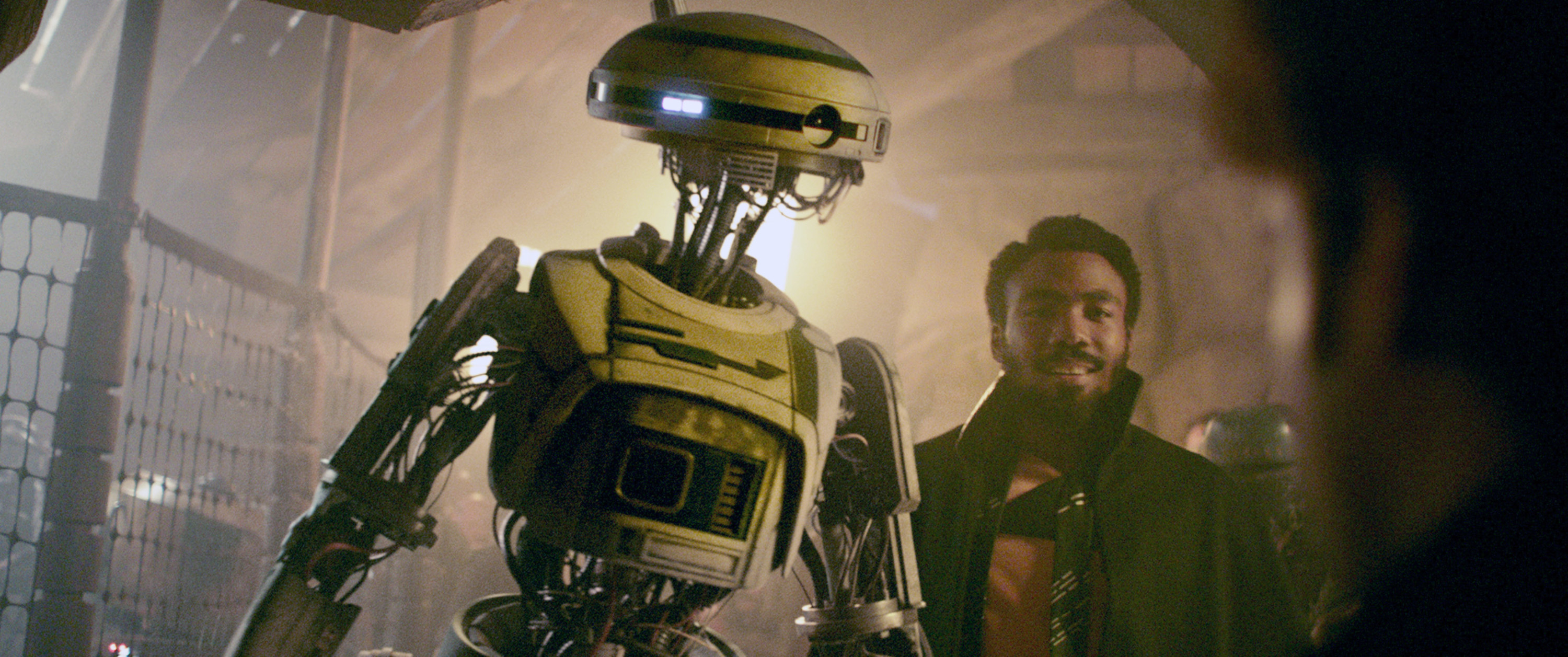 L3-37 standing next to Donald Glover in Solo