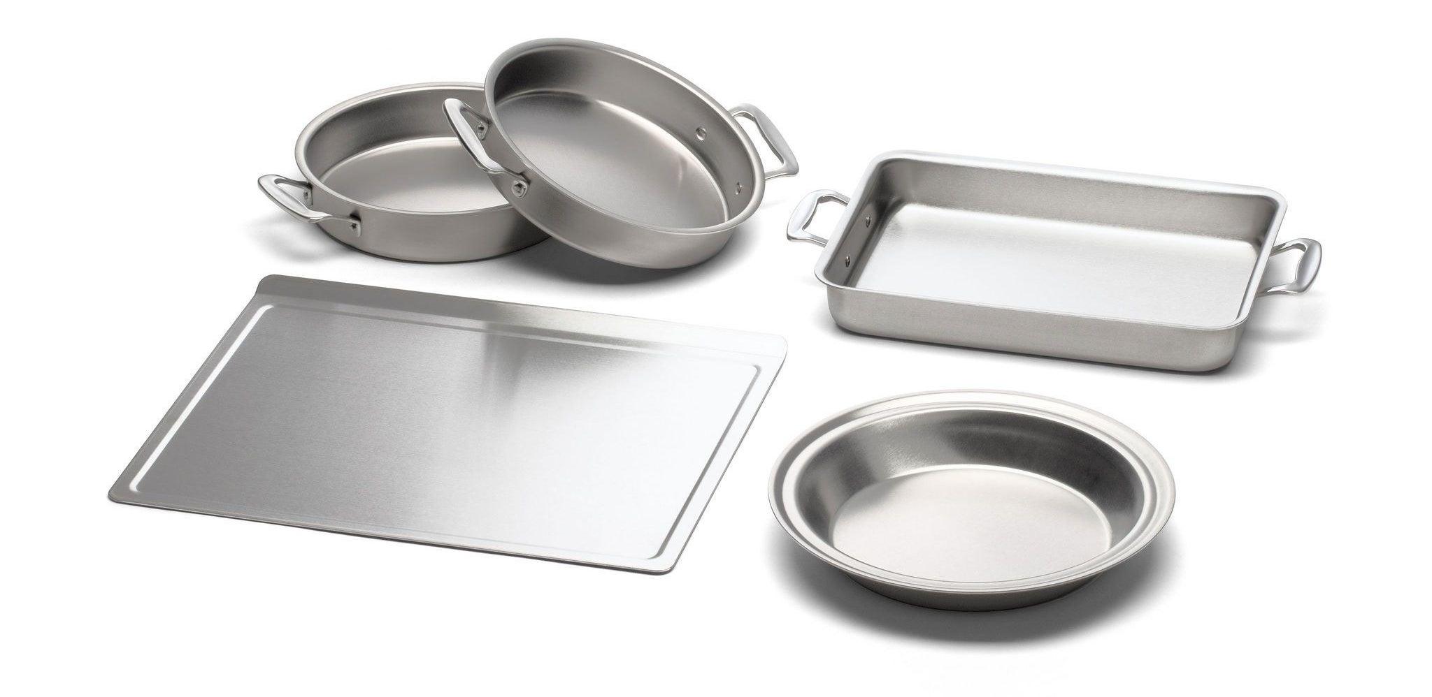 a sheet tray, three round pans, and a rectangular pan