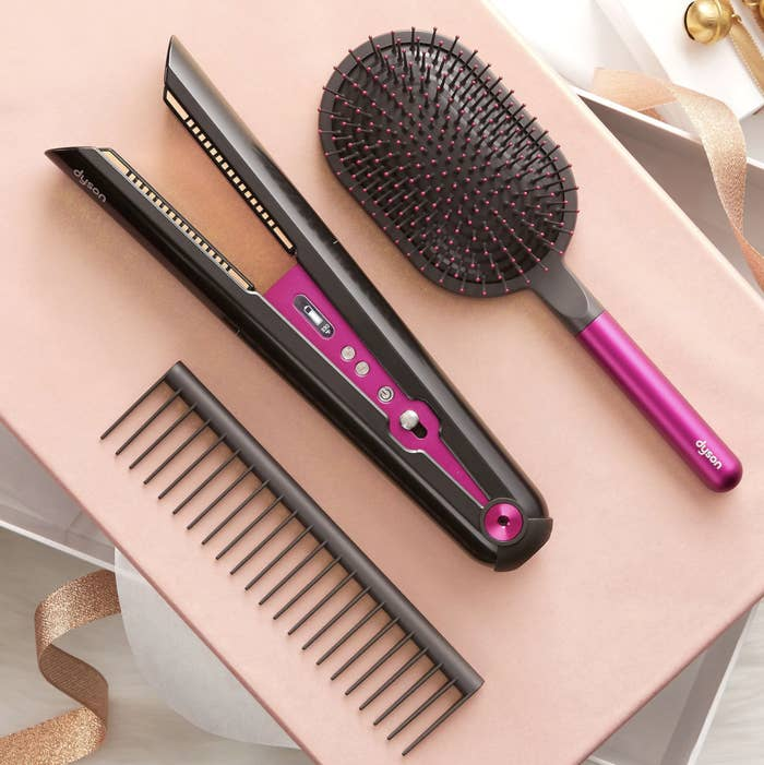 a comb, a paddle brush, and the straightner