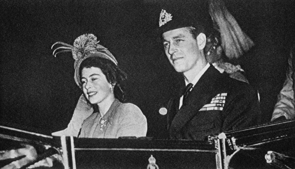 Prince Philip riding in a carriage with Elizabeth