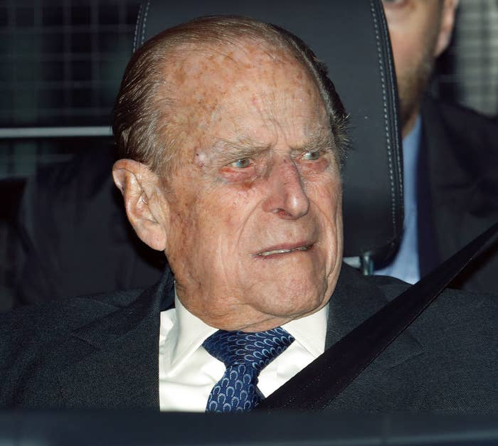 Prince Philip riding in a car