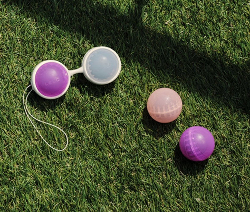The pack of Lelo beads on a patch of grass