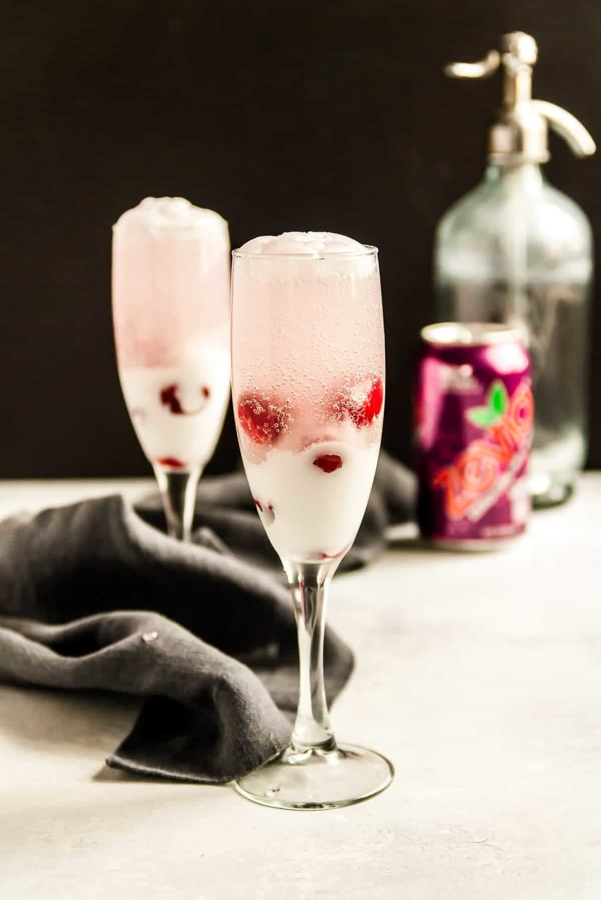 Champagne glasses filled with coconut cherry floats