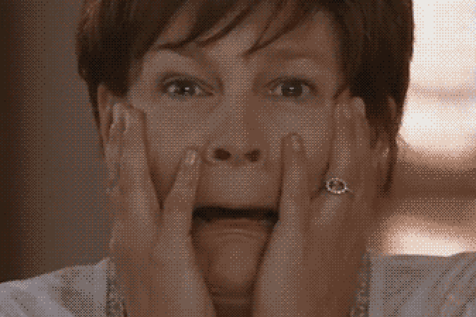 """Mom from """"Freaky Friday"""" looking shocked at her face"""