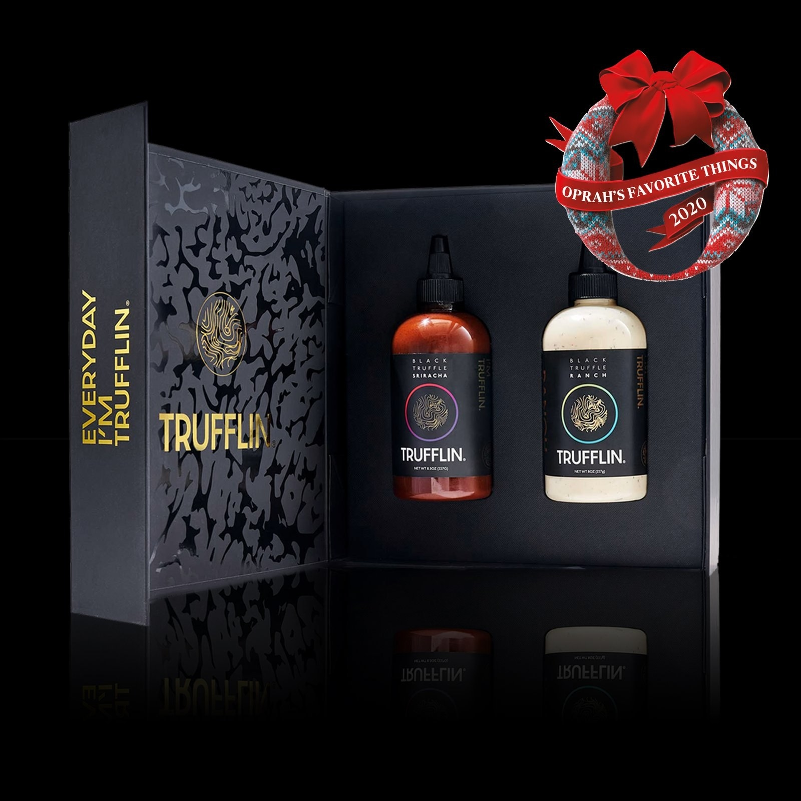 The bottle of sriracha and ranch in a black gift box
