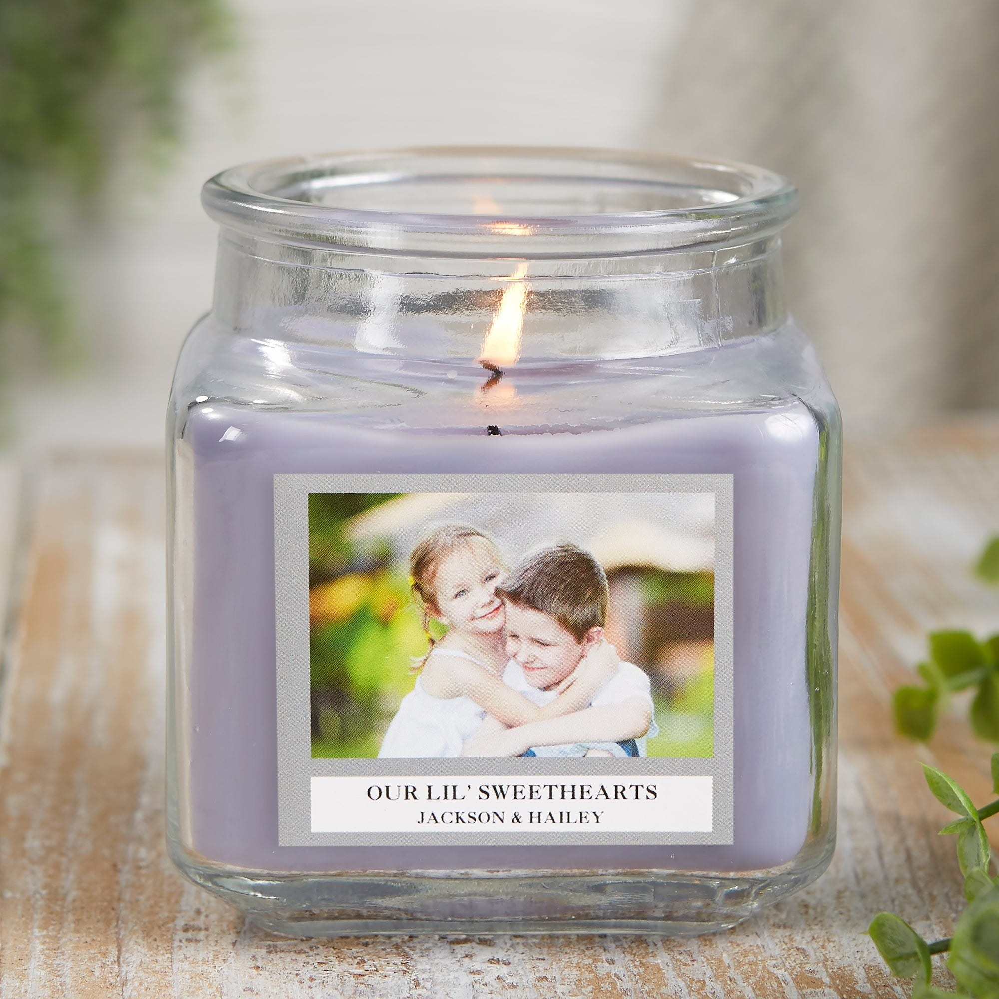 the 10 oz lavender candle with a picture of two kids and their names with a custom message