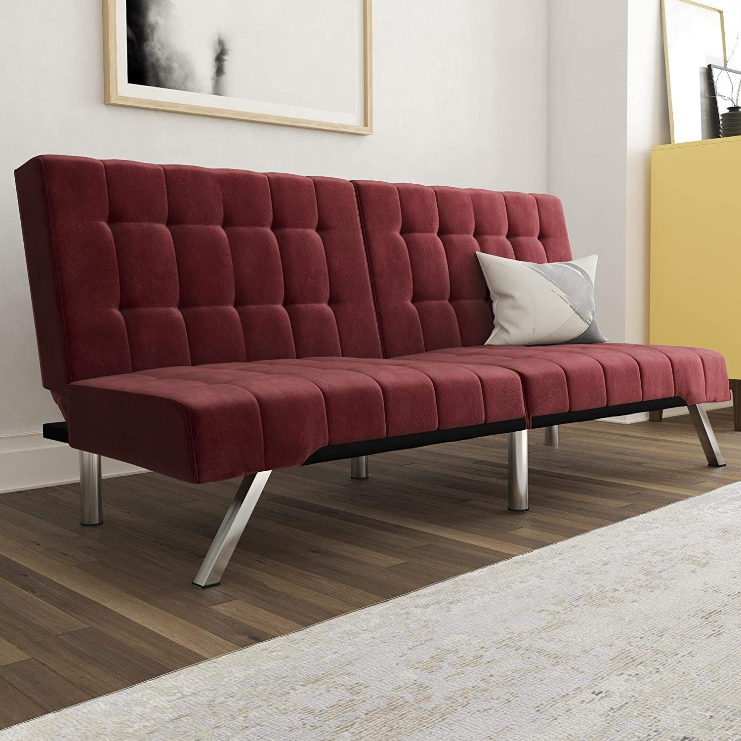 a red tufted futon