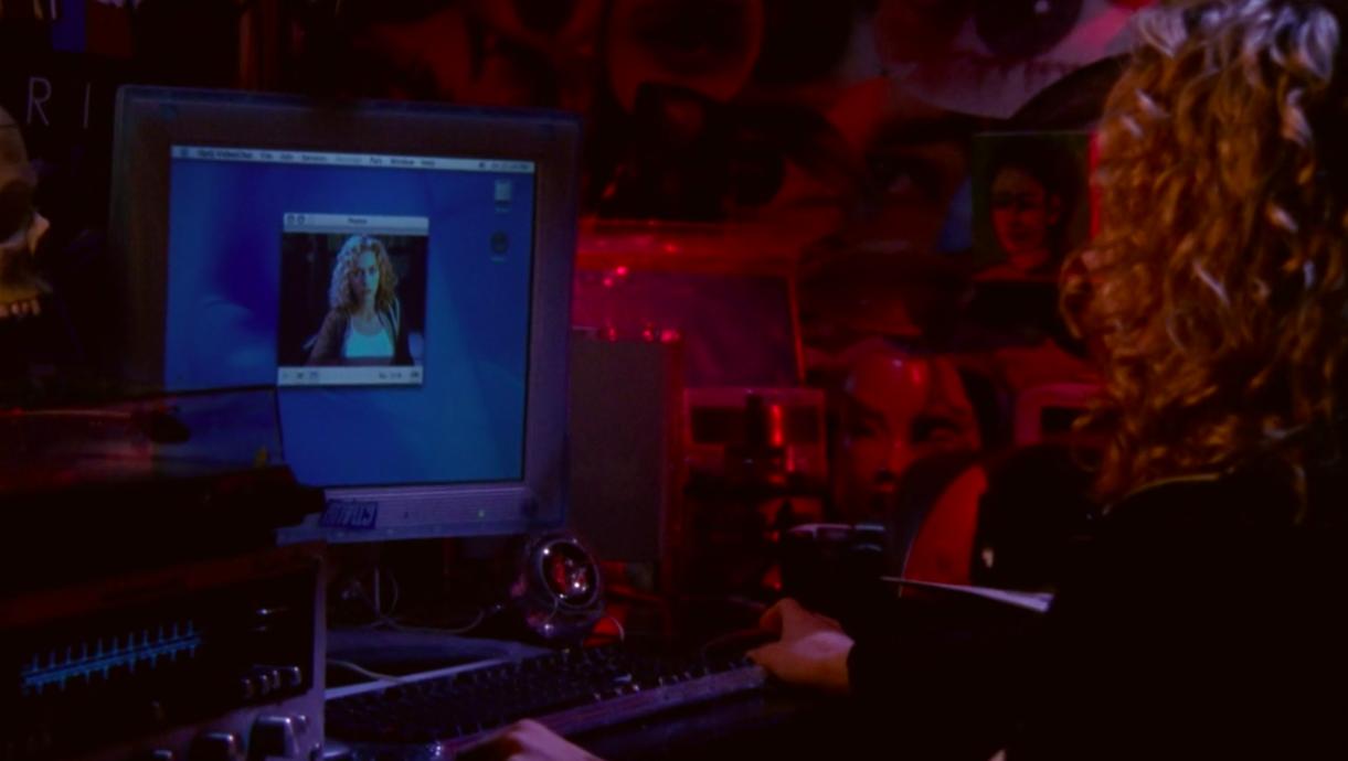 Peyton watching herself on webcam