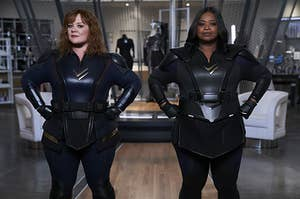 Emily and Lydia posing in their superhero suits