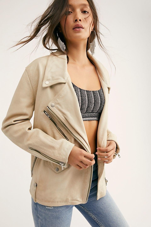 model wearing the leather jacket in tan