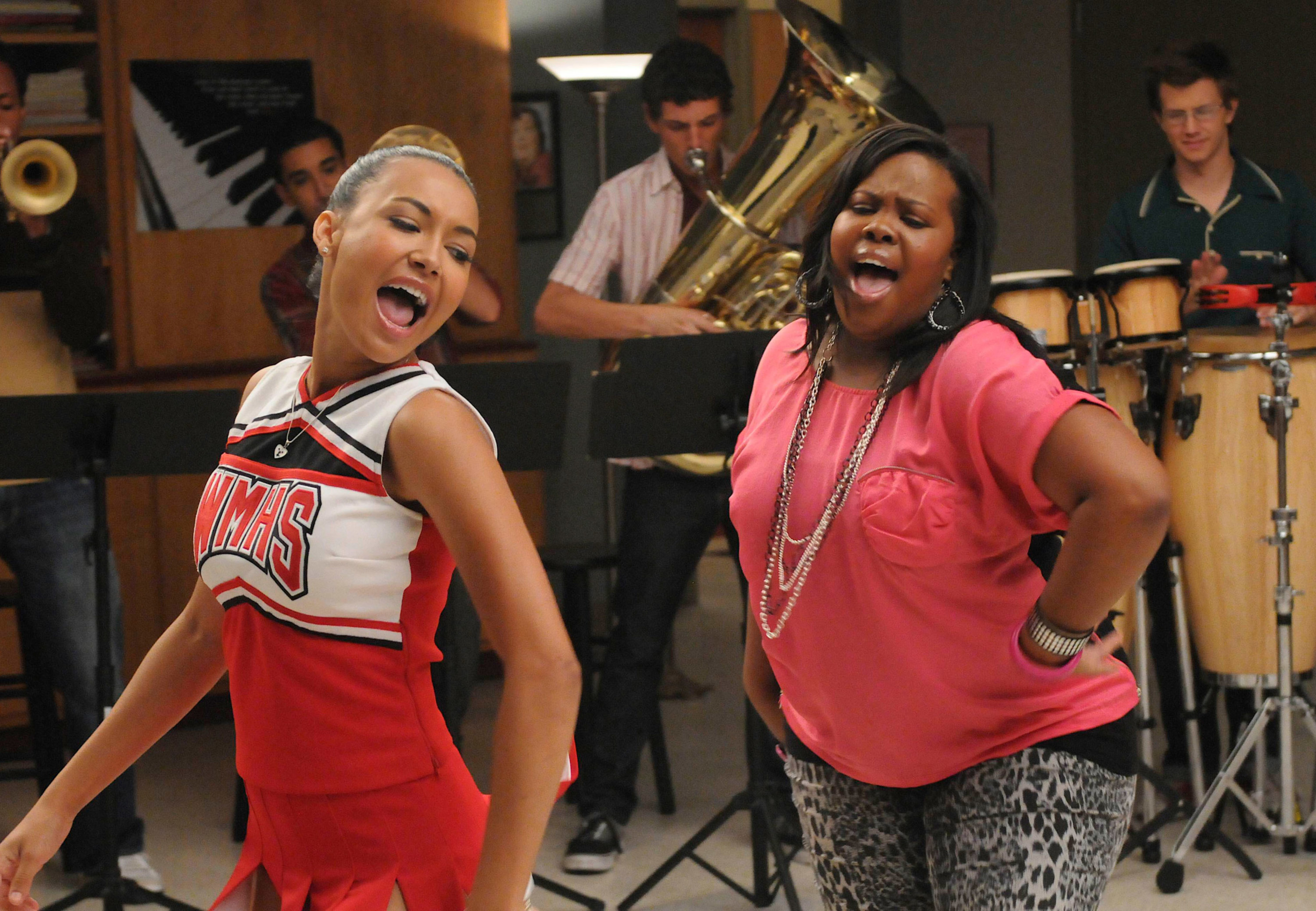 Rivera and Amber Riley sing in Glee